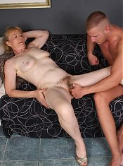 Blonde granny Maria and her young hottie start off with foreplay and welcomes a dick in her mouth and pussy