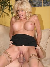 Lexi Carrington is a busty older MILF showing off her goods to a younger guy and getting laid
